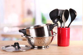 Kitchen tools on table in kitchen — Stock Photo