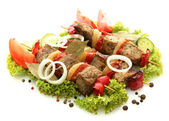 Tasty grilled meat and vegetables on skewers, isolated on white — Stock Photo