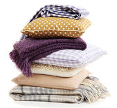 Hill colorful pillows and plaids isolated on white — Stock Photo