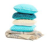 Hill colorful pillows and plaid on green background — Stock Photo