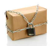 Parcel with chain and padlock, isolated on white — Stock Photo