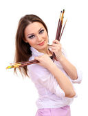 Beautiful young woman painter with brushes, isolated on white — Stock Photo