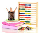 Bright wooden toy abacus, books and pencils, isolated on white — Stock Photo