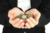 Woman hands with coins isolated on white — Stock Photo