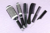 Black combs on color background — Stock Photo