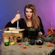 Halloween witch preparing poison soup in her cauldron on color background — Stock Photo #19022653