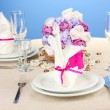 Table setting in purple tones on color  background — Stock Photo