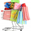 Christmas gifts and shopping in trolley isolated on white - Foto Stock