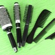 Black combs on color background — Stock Photo #19023721