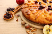 Tasty homemade pie with jam and apples, on wooden table — Stock Photo