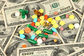 Pills and money close-up background — Stockfoto