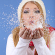 Winter woman blowing snow, on blue background — Stock Photo