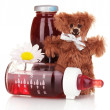 Baby bottle with fresh juice and teddy bear isolated on white — Stock Photo