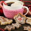 Cup of coffee with Christmas sweetness on wooden table close-up — Stock Photo #19086635