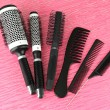 Black combs on color background — Stock Photo #19087535