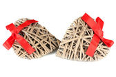 Wicker hearts with red bow isolated on white — ストック写真