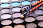 Eye shadows and brushes close-up — Stock Photo