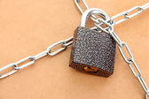 Parcel with chain and padlock, close up — Stock Photo