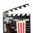 Movie clapperboard, cola and popcorn isolated on white — Stockfoto