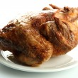 Tasty whole roasted chicken on plate, isolated on white — ストック写真