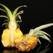 Sliced ripe pineapple isolated on black — Stock Photo #19159535