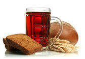 Tankard of kvass and rye breads with ears, isolated on white — Stock Photo