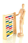 Bright toy abacus and wooden dummy, isolated on white — Stock Photo