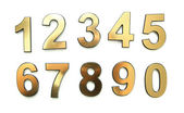 Golden numbers, isolated on white — Stock Photo