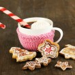 Cup of coffee with Christmas sweetness on wooden table close-up — Stock Photo #19164203