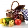 Picnic basket with fruits and blanket isolated on white — Stock Photo #19164367