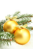 Christmas balls on fir tree with snow, isolated on white — Zdjęcie stockowe