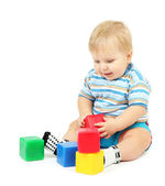 Little boy playing with multicolor blocks — Stock Photo