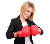 Young beautiful business woman with boxing gloves isolated on white — Stock Photo