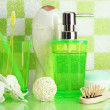 Bath accessories on shelf in bathroom on green tile wall background - ストック写真