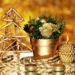 Christmas composition  with candles and decorations in gold color on bright background - Stock Photo