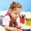 Cute little girl playing with multicolor pencils, on blue background — Stock Photo #19176173