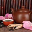 Chinese tea ceremony on bamboo table on bamboo background — ストック写真