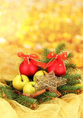 Beautiful christmas composition on yellow background — Stock Photo