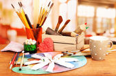 Artistic equipment: paint, brushes and art palette — Stok fotoğraf
