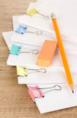 Documents with binder clips on wooden table — Stock Photo