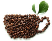 Coffee beans with leaves isolated on white — Stock Photo
