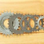 Metal cogwheels on wooden background — Stock Photo