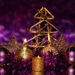 Stock Photo: Christmas composition with candles and decorations in purple and gold colors on bright background
