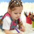Cute little girl playing with multicolor pencils, on blue background — Stock Photo #19277189