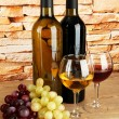 Composition of wine and grapes on table on brick wall background — Foto Stock