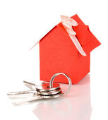 Small house with key isolated on white — Stock Photo