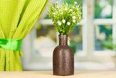 Decorative flowers in vase on windowsill — Stock Photo