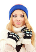 Young beautiful woman wearing winter clothing, isolated on white — Stock Photo