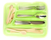 Green plastic cutlery tray with checked silver cutlery and wooden spoons isolated on white — Stock Photo