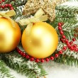 Stock Photo: Christmas balls on fir tree with snow, isolated on white